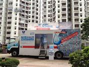 """Let's Save 10L Water"" Mobile Showroom(Image)"